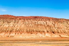 "Flaming mountains, Turpan, Xinjiang, China: these intense red mountains appear in the Chinese epic ""Journey to the west"". Flaming mountains, Turpan royalty free stock image"