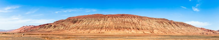 "Flaming mountains, Turpan, Xinjiang, China: these intense red mountains appear in the Chinese epic ""Journey to the west"". Flaming mountains, Turpan stock photography"