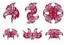 Flaming phoenix head symbols. Tribal symbols of the head of a bird Phoenix. Red on the white royalty free stock photos