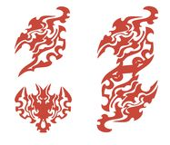 Flaming phoenix symbols. Tribal phoenix head. Red on the white stock photos