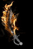 Flaming Pirate Cutlass Sword. Isolated on a Black Background Royalty Free Stock Images