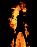 Flaming Pop Star. An abstract fire background with a girl singer complete with microphone Royalty Free Stock Image