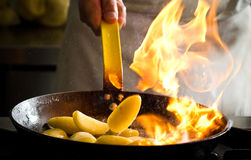 Flaming potatoes Stock Photo