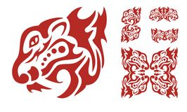 Flaming predator head elements. Tribal symbols of the tigers heads on a white background Stock Photography
