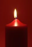 Flaming Red Candle Royalty Free Stock Photography
