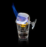 Flaming sambuca cocktail. On a black background royalty free stock photography