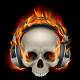 Flaming Skull. Wearing Headphones on black background Stock Photo