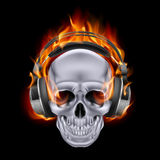 Flaming skull in headphones. Flaming skull in headphones on black background Stock Image