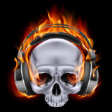Flaming skull in headphones. Royalty Free Stock Image
