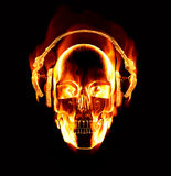 Flaming skull wearing headphones. Great image of flaming skull wearing headphones Stock Image