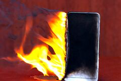 Flaming smartphone. The phone is on fire. Mobile smartphone blank flame