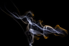 Flaming smoke. Incense in the room. The smoke can be beautiful Royalty Free Stock Photography