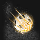 Flaming soccer ball. On dark background with fire and flame Royalty Free Stock Images