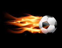 Flaming Soccer Ball. A flaming soccer ball flying against a black background. Vector EPS 10 available. EPS file contains transparencies and gradient mesh Stock Photography