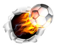 Flaming Soccer Football Ball Tearing a Hole in the Background Royalty Free Stock Images