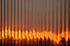 Flaming sunset. Against the side of a building Royalty Free Stock Photography
