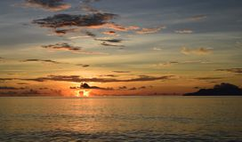 Flaming sunset over the Indian Ocean, Seychelles. stock photo