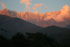 Flaming sunset over snowpeaked  himalayan ranges Stock Image