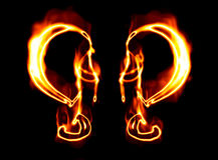 Flaming symbols Stock Images