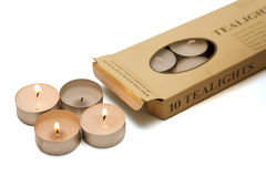 Flaming tealights in the box Stock Photography
