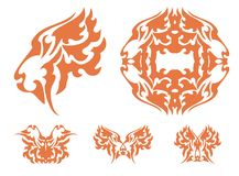 Flaming tiger symbols. Tribal haughty tiger head, circle and the butterflies formed by the tiger head. Orange on the white Royalty Free Stock Photos