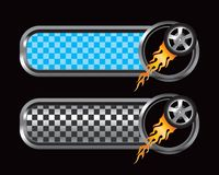 Flaming tire on blue and black checkered tabs. Flaming tire on blue and black checkered banners Stock Photos