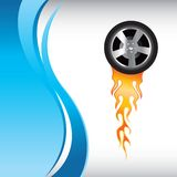 Flaming tire on blue wave background. Flaming tire on vertical blue wave background Royalty Free Stock Photo
