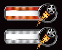 Flaming tire on orange and silver checkered tabs Stock Photos