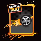 Flaming tire on orange splattered banner Royalty Free Stock Photography
