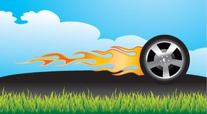 Flaming tire on pavement Royalty Free Stock Photo