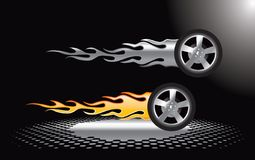 Flaming tires on checkered ground Stock Photography