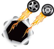 Flaming tires coming out of hole Royalty Free Stock Photo
