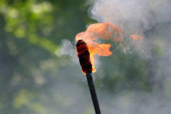 Flaming torch. With smoke and open fire Royalty Free Stock Image