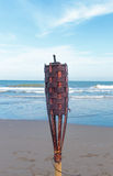Flaming torch on the beach Stock Photography