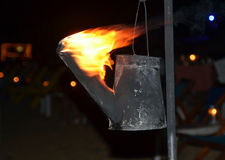 Flaming torch created from watering can photography Royalty Free Stock Images