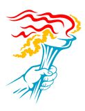Flaming torch in hand Stock Images