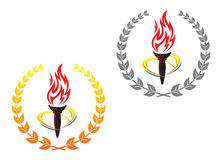 Flaming torches in laurel wreathes Stock Image