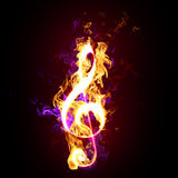 Flaming treble or G clef. Yellow and purple flames forming the musical symbol for the treble or G clef Royalty Free Stock Photos