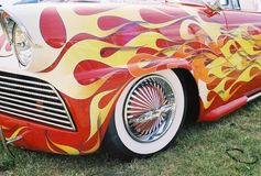 Flaming vintage car w/ naked lady rims. Flaming vintage car royalty free stock images