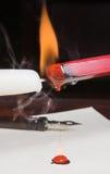 Flaming wax Stock Photos