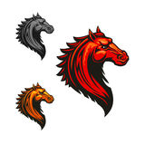 Flaming wild mustang horse for sporting design. Angry mad horse icon in fiery red, orange and grey colour variations. Flaming wild mustang, decorated by tribal Stock Photos