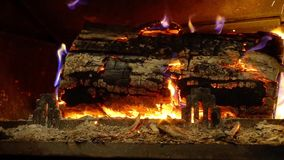 Flaming wood in fireplace closeup view, house and comfort stock footage