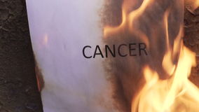 Flaming word cancer. 120 fps stock footage