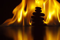 Flaming Zen. Zen Stack stones with fire background Stock Photo