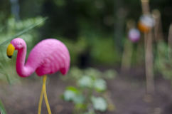 Flamingo in the garden. A few different light jars in the garden with a flamingo Royalty Free Stock Photos