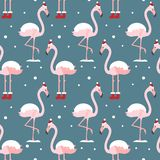 Flamingo i sömlös modell för julhatt på blå bakgrund Exotisk bakgrund f?r nytt ?r Jul planlägger för tyg, tapet, royaltyfri illustrationer