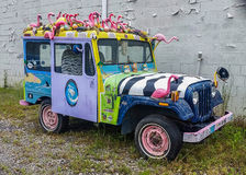 Flamingo Jeep. A jeep covered with plastic flamingo royalty free stock images