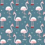 Flamingo no teste padrão sem emenda do chapéu do Natal no fundo azul Fundo ex?tico do ano novo Projeto do Natal para a tela, pape ilustração royalty free