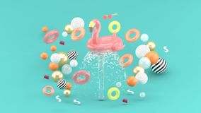 Flamingo rubber ring floating on a fountain surrounded by colorful rubber rings on a blue background stock photo