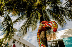Flamingo Statue with Palm Trees Stock Images